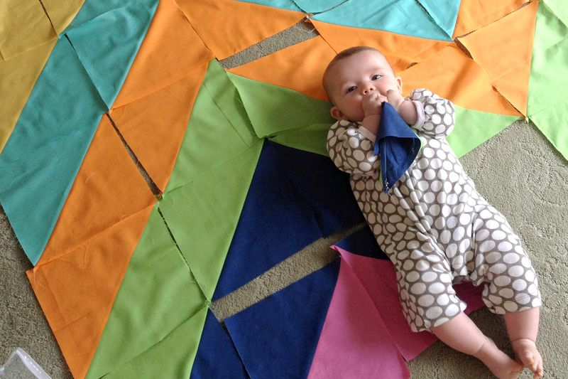 Baby chewing on fabric