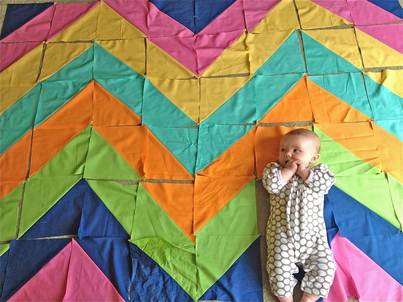 Baby on pieced quilt